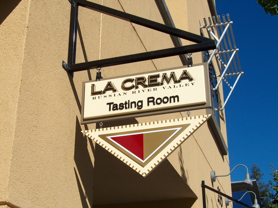 La Crema MDO plywood blade sign with 23K gold 2D letters and custom bracket