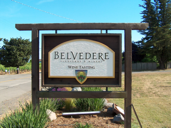 Belvedere hand carved urathane sign with distressed redwood posts and background panel.  This sign is a true
