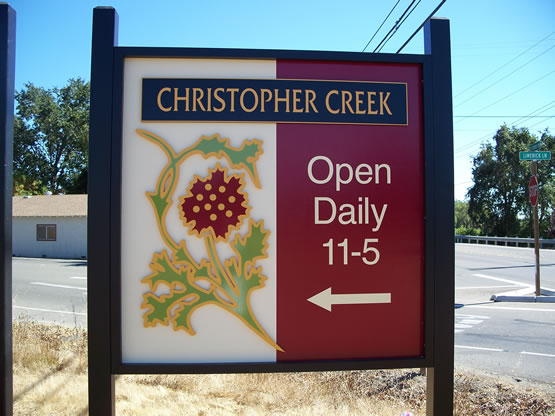 Christopher Creek is a MDO plywood sign with the logo & main copy panel in 1/2