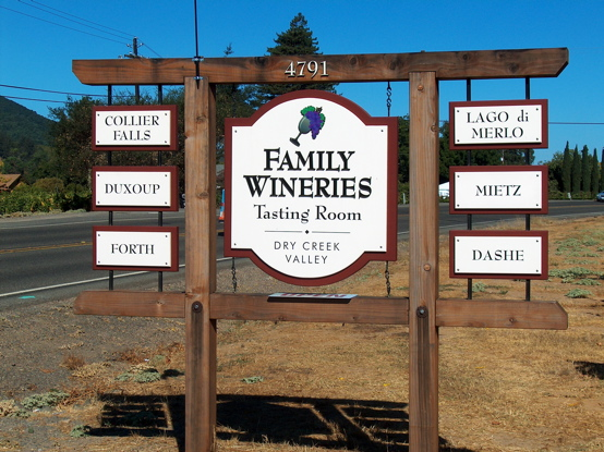 Matted wood signs on natural redwood structure.  We mounted 