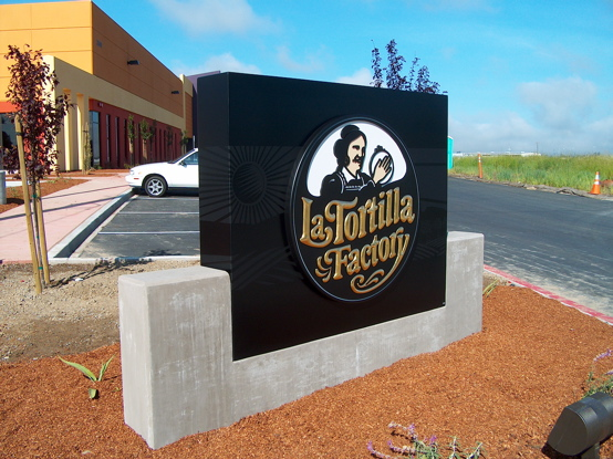 Fabricated aluminum box with flat black vinyl graphics under 
