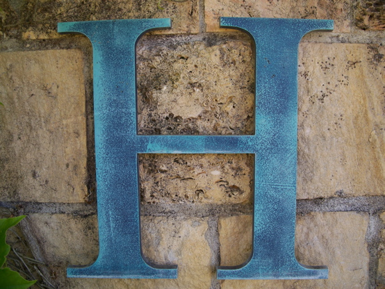 Faux finished aluminum letter.  Painted 